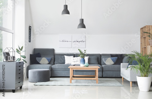 Stylish interior of living room with comfortable sofas and table Fototapet