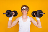 Close-up portrait of his he nice attractive funky cheerful cheery motivated guy sportsman lifting barbell doing good work out isolated over bright vivid shine vibrant yellow color background