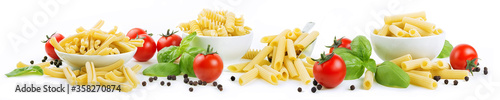 Fotografiet Four formats of artisanal durum wheat pasta: casarecce, tortiglioni, penne rigate and sedani rigati isolated on a white background with cherry tomatoes, basil and peppercorns