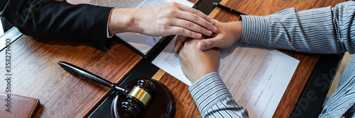 Fotografiet Male lawyer discussing negotiation legal case with client meeting with document