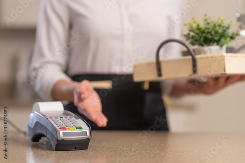 Payment for a service in a restaurant or cafe, a terminal for payment against th Wallpaper Mural