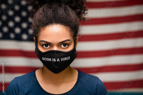 Stampa su Tela Black woman wearing protective mask text Racism is a Virus