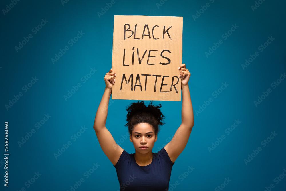 Fototapeta African american woman holding placard Black lives matter