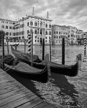 Moored Gondolas On The Grand Canal In Venice