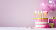 Pink Birthday Cake With Golden Candles
