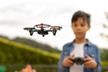 Close Up Of Child Flying Drone...