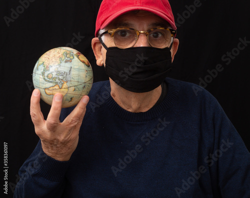 old man with mask and globe Canvas Print