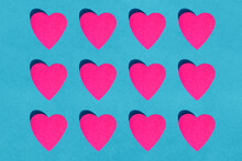 Pattern Of Pink Paper Hearts Against Blue Background