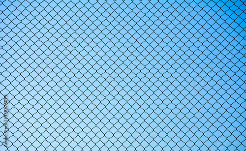 Cuadros en Lienzo Wire mesh steel on blue sky background