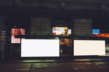 Bus Station Billboards With Blank Copy Space Screens For Advertising Text Message Or Promotional Content, Empty Mock Up Lightbox For Information, Bus Stop Shelter Clear Display In City Street At Night