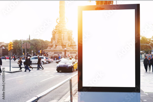 Obraz Blank billboard with copy space for your text message or content, outdoors advertising mock up, public information board on city road, flare sun light. Empty Lightbox on urban setting sidelines - fototapety do salonu