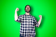 Leinwandbild Motiv Portrait of a cheerful young man showing okay and victory gesture isolated on the chroma background