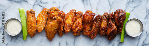 Fototapeta line of buffalo wings with different flavors obraz