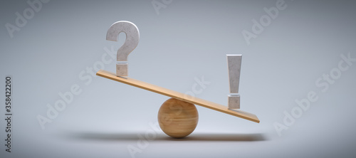 wooden scale balancing a question mark and an exclamation mark tipping more the Canvas Print