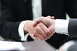close up. business partners, confirming their agreement with a handshake.