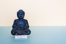 With Wooden Stamps The Word Holy Is Formed Below The Buddha Figure