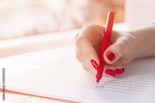 Valokuvatapetti Editor or teacher hand with red pen proofreading errors in a manuscript essay