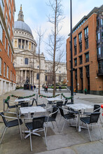 View Of The Famous St. Paul's Cathedral Behind Cafe Tables With Christmas Decorations On A Cloudy Day In London, England