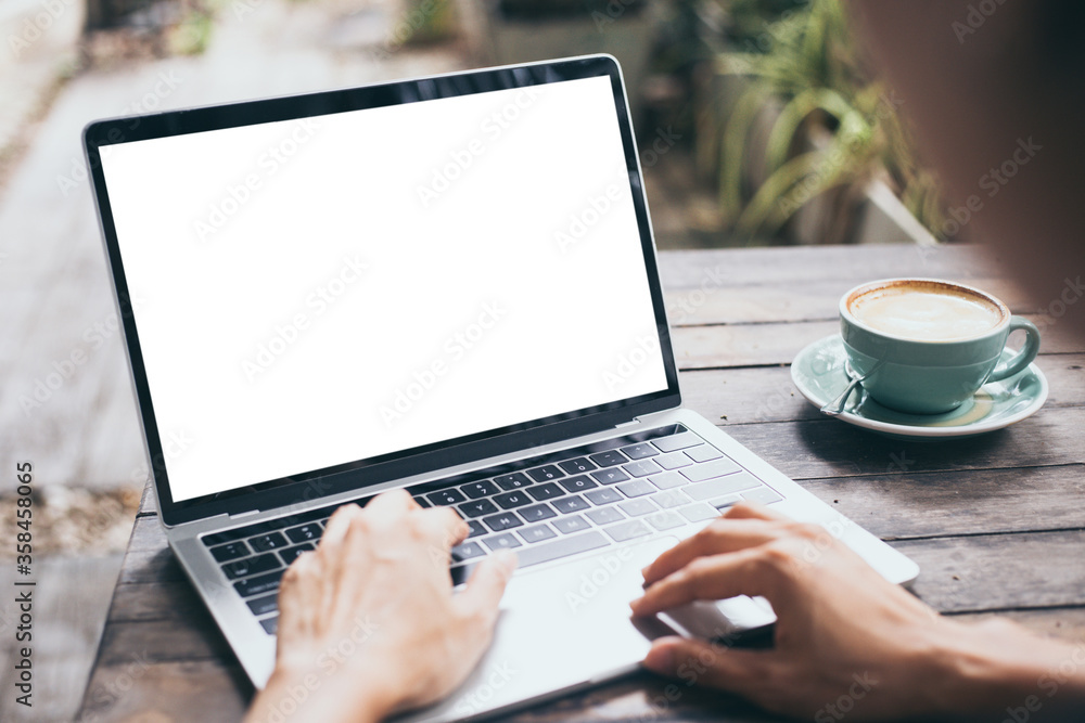 Fototapeta computer mockup image blank screen.hand woman work using laptop with white background for advertising,contact business search information on desk at coffee shop.marketing and creative design