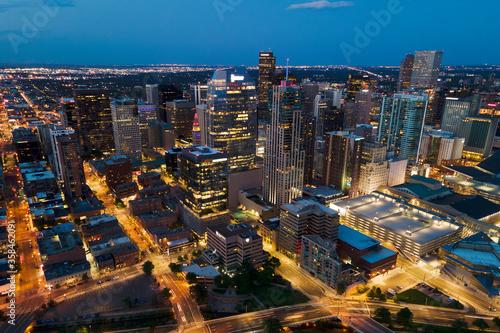 city skyline tall buildings denver at night