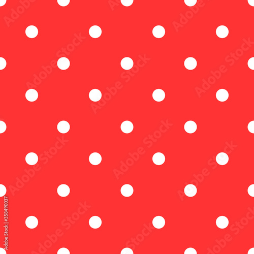 Simple red and white polka dot pattern. Seamless ornament with small round shapes.
