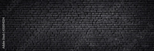 Fotomural Texture of a black painted brick wall as a background or wallpaper