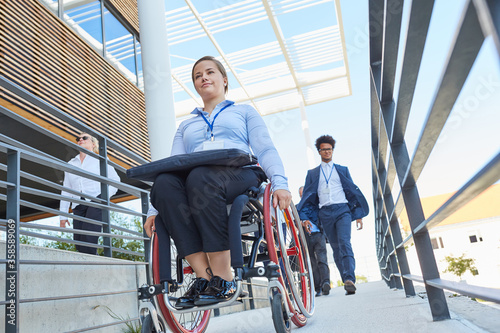 Tableau sur Toile Disabled woman in a wheelchair on a ramp