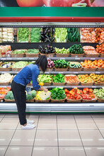 Girl Buying Fruit And Vegetabl...