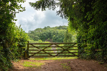 A Wooden Gate Into A Field Wit...