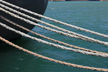 The Ship Is Tied With Ropes To...