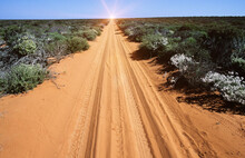 Desert Road With Van Tracks In Outback