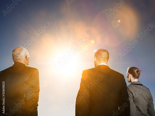 Fotografía Isolated photo of Rear view of three business people looking at sun
