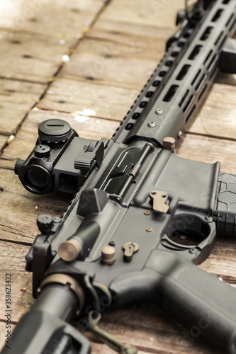 AR15 automatic assault rifle weapon with aim sight and flashlight Fototapeta