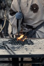 Closeup Shot Of The Medieval Blacksmith At Work With Glowing Irons