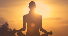 Silhouette Of A Woman Meditating In The Sunset