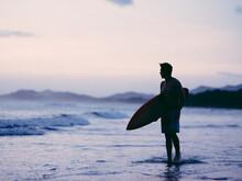 Silhouette Of Male Surfer Stan...
