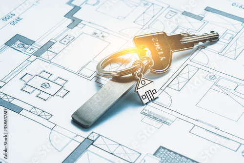 House keys on a house plan blueprint #358647617
