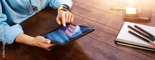 Fotografía Woman pointing on digital tablet screen, chatting in social networks, meeting website, searching internet, sending sms, using text messenger or online banking