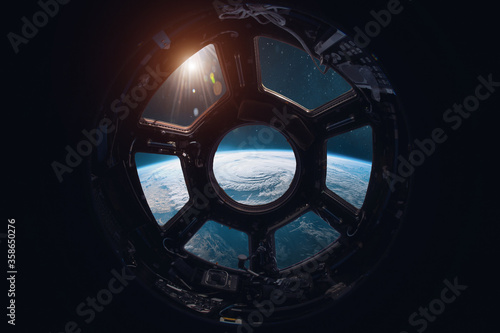 Fotografia View on Earth planet from ISS station porthole