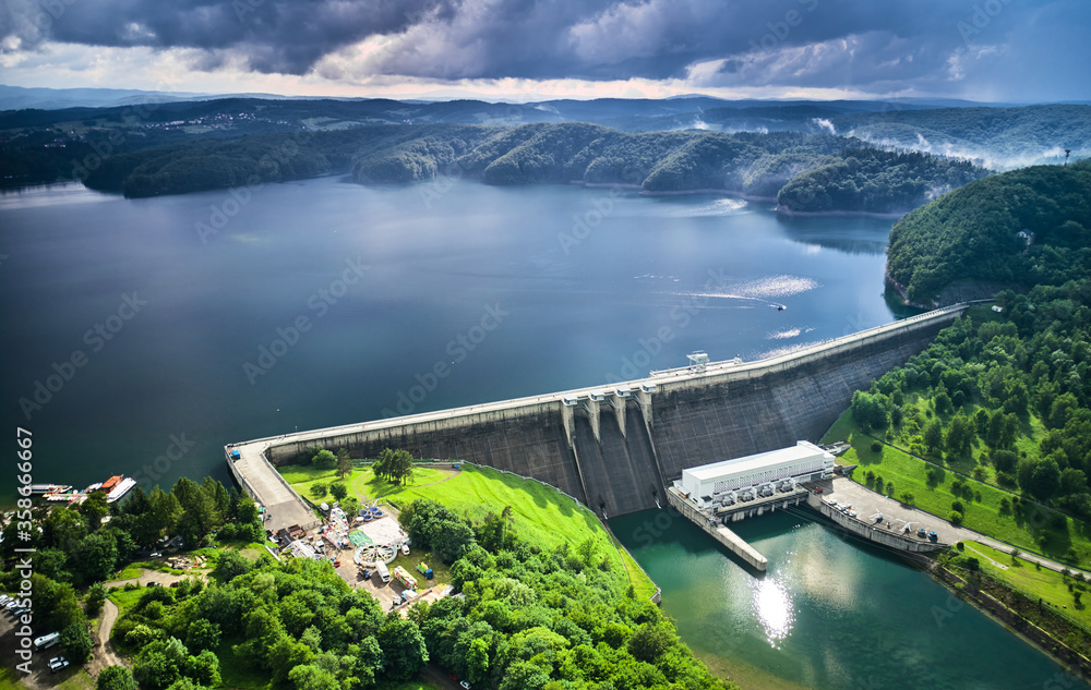 Fototapeta The Solina Dam aerial view, largest dam in Poland located on lake Solina. Hydroelectric power plant in Solina of Lesko County in the Bieszczady Mountains area of south-eastern Poland.