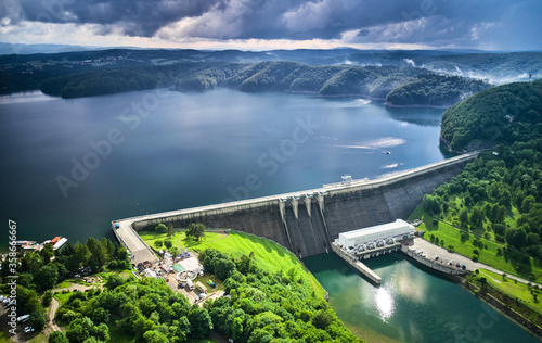 Fototapeta The Solina Dam aerial view, largest dam in Poland located on lake Solinskie. Hydroelectric power plant in Solina of Lesko County in the Bieszczady Mountains area of south-eastern Poland. obraz