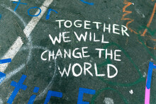 "Admonition ""together We Will Change The World"" Statement On Pavement At 38th And Chicago Where George Floyd Died. Minneapolis Minnesota MN USA"