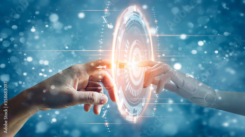 Fototapeta Hands of robot and human touching on big data network connection, Science and artificial intelligence technology, innovation and futuristic, AI, Machine learning. obraz