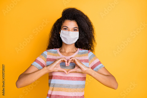 Close-up portrait of her she nice healthy wavy-haired girl wearing safety mask showing heart shape influenza grippe contamination isolated bright vivid shine vibrant yellow color background