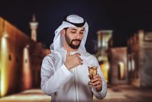 Arab Man Holding Bakhour Holde...