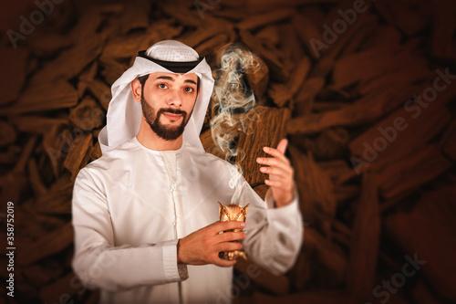 Tablou Canvas Arab man holding Bakhour holder celebrating the holy month of Ramadan Kareem, Ar