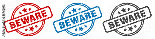 beware stamp. beware round isolated sign. beware label set Wallpaper Mural