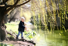 Little Boy By The River. He Is...