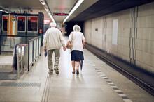 Elderly Couple Holding Hands I...
