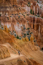 Hiker Among Hoodoos At Bryce Canyon National Park